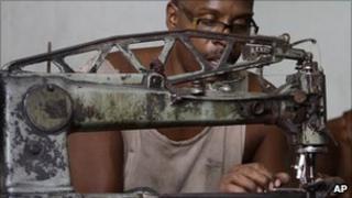 Manuel Cardenas repairs shoes in La Habanera state-run workshop in Havana