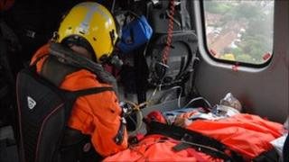An injured crewman on board the coastguard rescue helicopter from Lee on Solent
