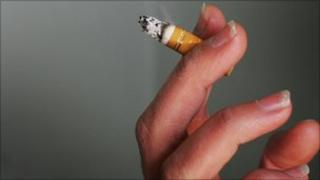 woman's hand holding a cigarette