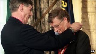 Microsoft co-founder Bill Gates, right, is presented with the Boy Scouts Silver Buffalo award by Wayne Perry, national president of the Boy Scouts