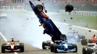 The Prost racer of Brazilian Luiciano Burti is up in the air while debris flies around after a crash at the start of the German Formula 1 Grand Prix at the Hockenheim track, Germany, Sunday, July 29, 2001.