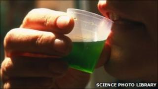 Drug addict drinking a measure of the drug methadone (file photo)