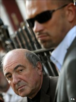 Boris Berezovsky (left) with a bodyguard outside the Russian embassy in London, 31 August