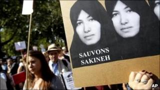 Demonstrators holds a picture of Sakineh Mohammadi Ashtiani a 43-year-old mother of two, who was sentenced to death in Iran, in Paris