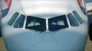 Pilots in the cockpit of a British Airways plane