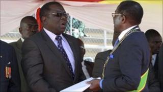 Zimbabwe's President Robert Mugabe (L) meets Prime Minister Morgan Tsvangirai