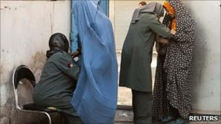 Women searched at polling station in Herat. 18 Sept 2010