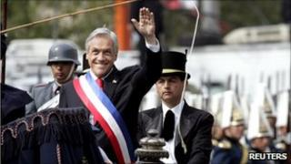 President Sebastian Pinera arrives at a mass to mark Chile's bicentenary accompanied by a military escort.