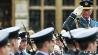 Prince Charles salutes after a thanksgiving service for the 70th anniversary of the Battle of Britain