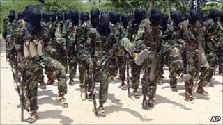 Al-Shabab fighters conduct military exercises in northern Mogadishu