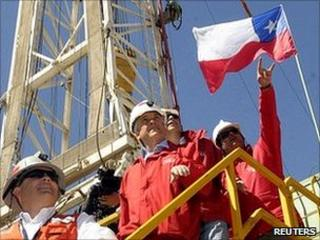 President Sebastian Pinera beside the giant oil drill digging to rescue the miners