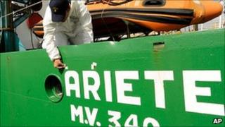 A forensic police officer examines the Ariete fishing trawler in Sicily, 15 September 2010