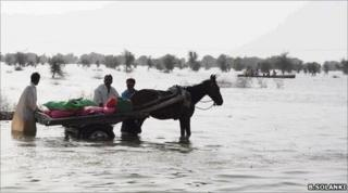 A family trying to rescue their belongings