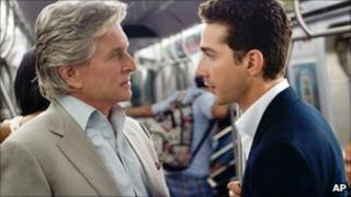 "Michael Douglas portrays Gordon Gekko, left, and Shia LaBeouf portrays Jake Moore in a scene from, ""Wall Street: Money Never Sleeps."""