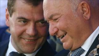 Moscow Mayor Yuri Luzhkov (R) talking with Russian President Dmitry Medvedev (L)