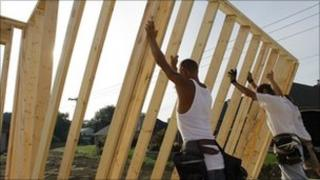 Construction workers begin building new home in Springfield, Illinois