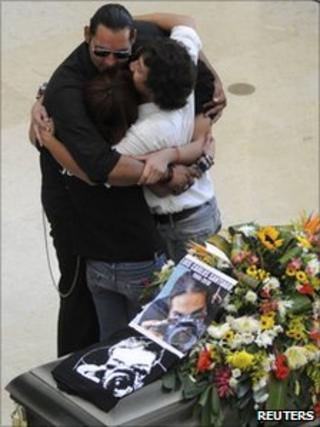 Mourners at the funeral of El Diario photographer Luis Carlos Santiago on 18 September