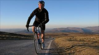 Robert Penn rides on Llangynidr moor, with the Black Mountains in the background
