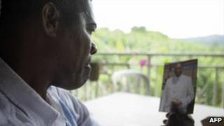 Alex Dole looks at a photo of his kidnapped son Thierry at his home on the French Caribbean island of Martinique, 19 September