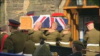 Kingsman Deady's coffin being carried into church