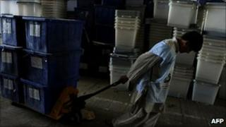 An Afghan election worker sort ballot boxes in Kabul