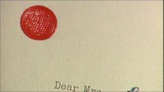 letter with red spot