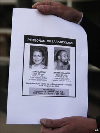 France's ambassador to Bolivia Antoine Grassin holds a missing persons' poster showing Jeremy Bellanger, 25, right, and Fanny Blancho, 23, in La Paz, Bolivia, on 22 September 2010