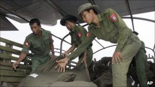 File image of Burmese soldiers delivering Thai aid in the wake of Cyclone Nargis on 11 May 2008