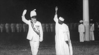 Nigeria's new prime minister Alhaji Sir Abubakar Tafawa Balewa and the British government representative James Robertson