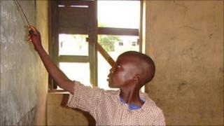 Nigerian boy writing on the blackboard