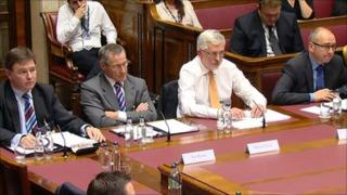 Bankers sitting before a Stormont committee