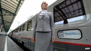 A conductor stands by the new train in Moscow's Belorussky Station, 23 September