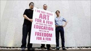 British artists Mark Wallinger, left, David Shrigley and Jeremy Deller, right, pose for the media as they launch a campaign to lobby against the Governments proposed 25 per cent cuts in arts funding, in London Friday, Sept. 10