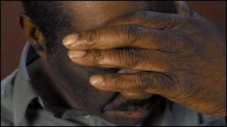 Man with hand over his face
