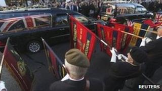British Legion members lower their standards as the coffins of Trooper Andrew Howarth and Sergeant Andrew Jones are driven through Wootton Bassett