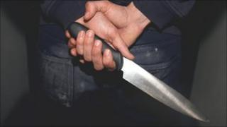 person holding a knife