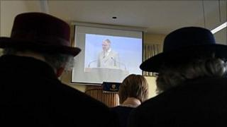 Congregation in Paisley watch the Glasgow service