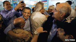 Members of the Venezuelan opposition group the Table for Democratic Unity (MUD) celebrate results of parliamentary elections in Caracas on Monday