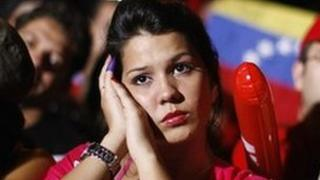 Supporters of Venezuela's President Hugo Chavez listen to the electoral results in Caracas early on Monday morning