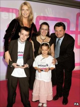 Alexander Ellwood, front left, with model Penny Lancaster, TV presenter Chris Hollins and another winner at the WellChild Awards.