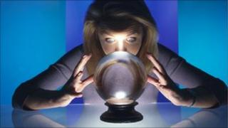 Fortune teller gazing into a crystal ball
