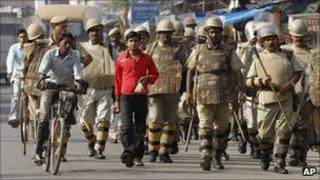 Indian security personnel patrol a street in Ayodhya