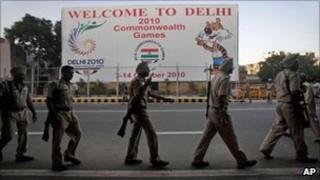 Indian policemen patrol near the Jawaharlal Nehru stadium, in Delhi