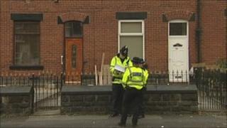 Police outside a house in Alfred Street, Bury