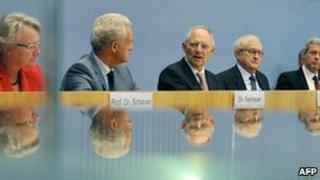 Five German cabinet ministers gather in Berlin to argue for the reactor extension, 28 September