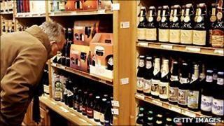 A man looks at Belgian beers