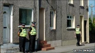 Officers standing outside Derrick Bird's home