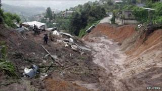 Rescuers at the scene of the landslide in Santa Maria Tlahitoltepec