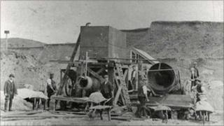 Workers taking part in sand washing