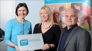 Alice Lewis (Project co-ordinator with RNIB), Brenda Hegarty, SEUPB and Barry MaCaulay (Snr Manager with RNIB) at the Derry office of the RNIB.